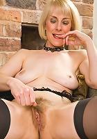 52 year old Hazel struts her stuff then spreads her legs on camera