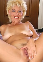 Elegant blonde MILF spreads her legs wide for us all
