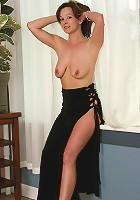 Elegant Samantha playfully posing in a black dress