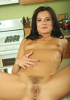 Giggling MILF CeCe from AllOver30 spreads wide in the kitchen