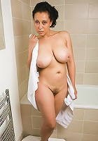 Exotic and mature Danica soaks her tight pussy in the tub
