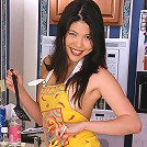 Watch as Enola flips her burger in the kitchen fo you