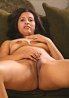 Exotic Angel plays with her spicy pussy on the sofa