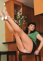 Watch 42 year old Claudine stick her tongue between her mature toes