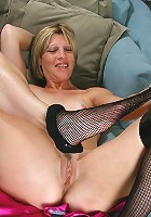 Maya D shows off her sexy mature feet and licks her toes in here