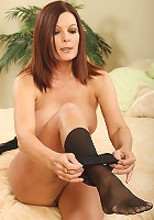 Tight bodied MILF slips off her nylons and plays with her sexy feet