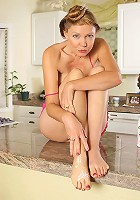 Playful Lilli from AllOver30 smears chream between her toes