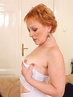 50 year old redheaded Edo spreading her furry pussy wide for you