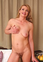 Liz M spreads her moist 44 year old pussy open in the white chair