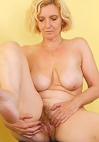 All natural blonde Hillary spreading her 51 year old hairy pussy wide
