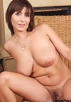 All natural and furry housewife Sophia M spreads her pussy wide