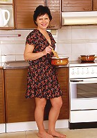 After cooking Eva D relaxes and spreads her hair pussy for you