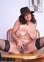 Very hairy pussied mature brunette spreads her legs wide