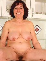 63 year old Hannah plays with her furry bush at home