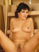 33 year old Valentina slips off her denim skirt and spreads meaty pussy