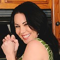 Sexy brunette RayVeness slips her finger into her pussy on the counter