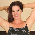 Playful 39 year old Xena gets naked and plays around on her bed