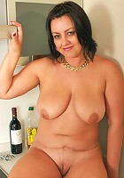 Mature 43 year old housewife enjoys her pussy with her coffee
