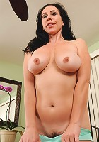 Mature housewife Kira I slips off her blus panties and squeezes tits