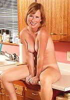 Sexy 42 year old Cheyanne bends over the kitchen counter in here