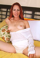 Long haired redhead shows off her perfect body and granny panties