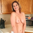 Busty Ellen from AllOver30 streatches her mature and meaty pussy