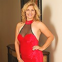 45 year old Tara from AllOver30 poses in and out of her red dress