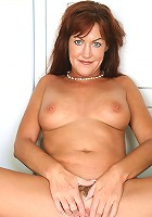 Long haired 40 year old Shauna pinches her nipples just for us