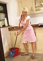 Hot housewife Jan strips off her clothes while doing her chores