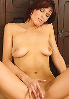 Tight bodied Estella fingers her mature pussy for our cameras