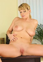 Hot blonde MILF does housework and fucks her broom