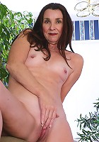 Jasmine fingers her 52 year old pussy in the backyard