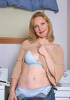 Innocent looking MILF spreads her legs for the camera