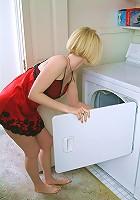 Blonde MILF gets hot doing laundry so she strips naked