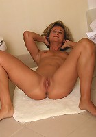 Tight mature Bianca plays around in and out of the shower