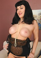 New mature model Claudine dips a strand of pearls into her mature box