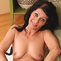 52 year old Kitty S showing off her mature body in hot pink lingerie