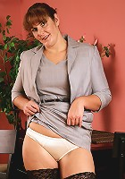 Redheaded and horny 35 year old Julie in secy black stockings here
