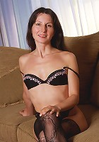 Petite 41 year old MILF Carment T preads her lacey legs wide here
