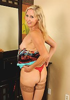 55 year old Annabelle posing in her red hot thongs and stockings