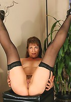 Blonde MILF in see through lingerie spreads her shaven gash