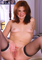 Redheaded MILF in sexy lingerie slips it odd and spread shaved pussy