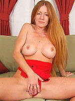 Redheaded MILF Wendy waits naked on the couch for Santa