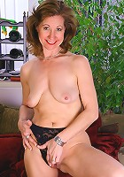 Knockout mature chick strips and plays with her pussy