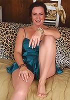 Brunette MILF in sheer blue lingerie poses for us in here