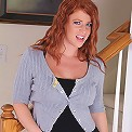 Big breasted older redhead Sara Orlando in only heels.