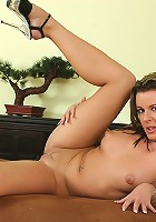 Sexy MILF Lenny strips and toys her wet older pussy.