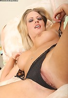Older nympho Holly strips off her black panties and plays with her favorite dildo.