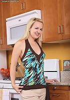 Kinky housewife Hannah strips n her kitchen.