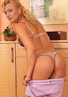 Tall mature blonde Sophia Magic fingers pussy in kitchen.
